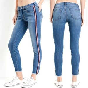 Just black jeans with red side stripe